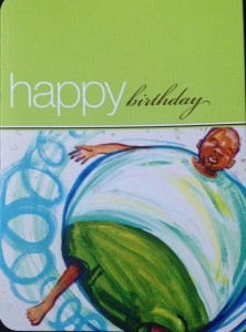 A birthday card with an African-American boy blowing away like a balloon